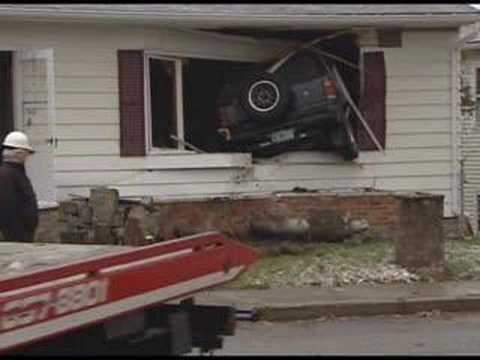 SUV-crashes-into-house.jpg