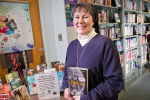 Sister Kimberly Miller of Little Flower H.S. is organizing its 1st Little Flower Teen Author Festival. Photograph in school library with display of books written by young authors that will attend the festival. Picture taken on Thursday afternoon February 20, 2014. ( ALEJANDRO A. ALVAREZ / STAFF PHOTOGRAPHER )